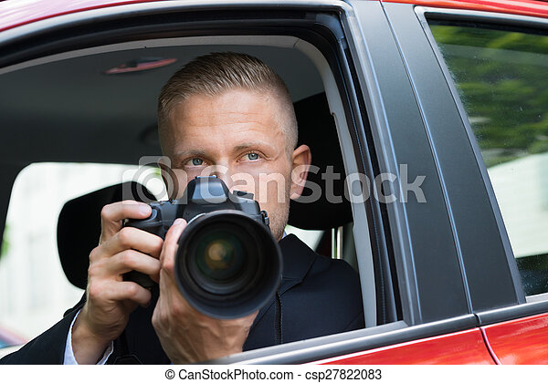 Man Photographing With Slr Camera From Car - csp27822083