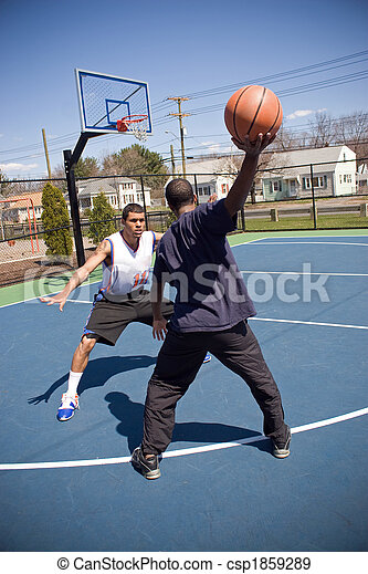 Man Playing Basketball - csp1859289