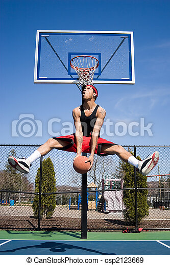 Man Playing Basketball - csp2123669