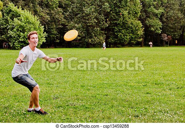 man playing frisbee - csp13459288