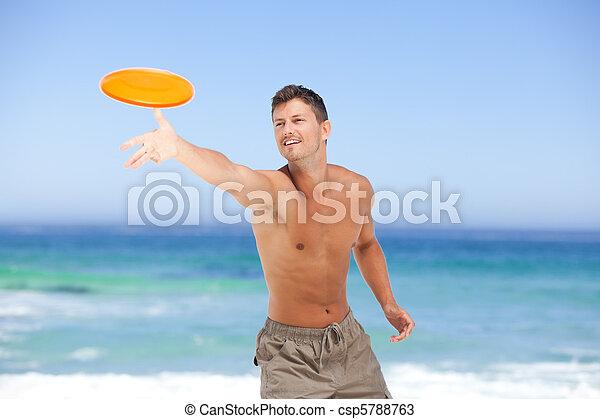 Man playing frisbee - csp5788763