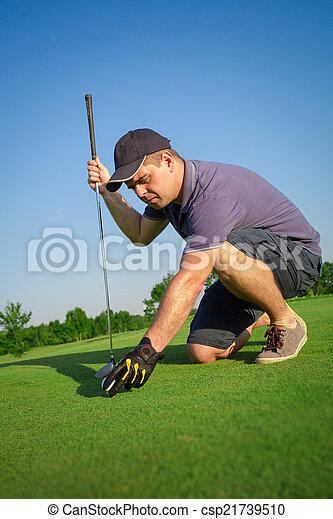 Man playing golf - csp21739510