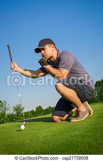 Man playing golf - csp21739508