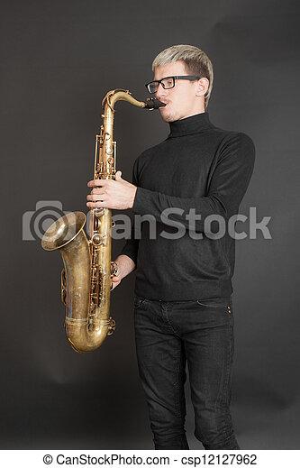 man playing the saxophone - csp12127962