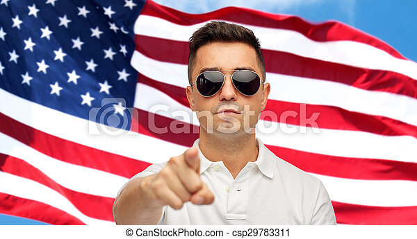 56d109e216a27 Man pointing on you over american flag background. Summer ...