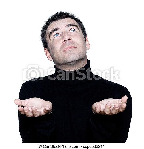 man ponder praying looking up - csp6583211