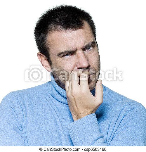 man portrait biting nails anxious nervous - csp6583468
