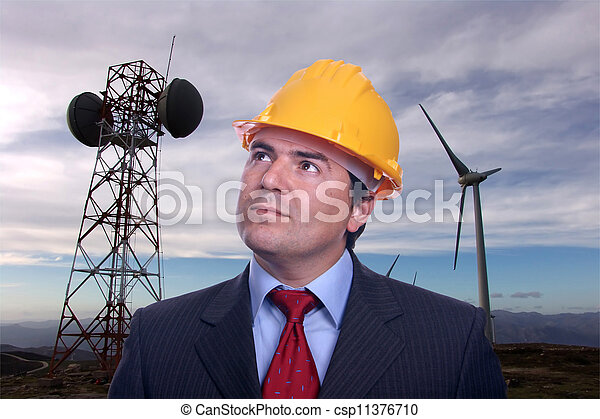 man portrait construction hat on Eolic energy turbines background - csp11376710
