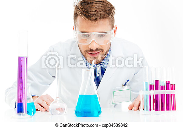 Man pouring chemicals - csp34539842