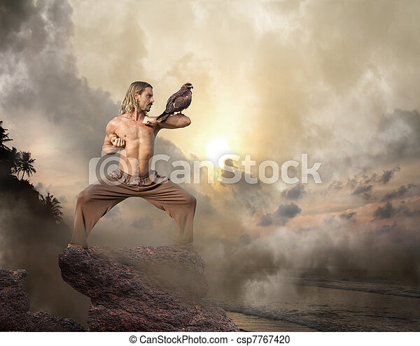 Man Practices Martial Arts with Bird of Prey at Dawn - csp7767420