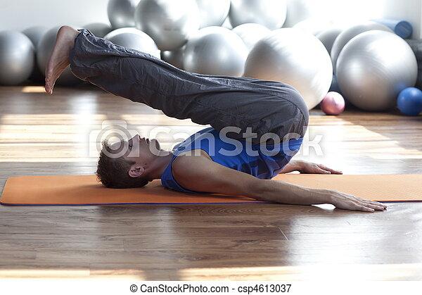 man practicing pilates - csp4613037