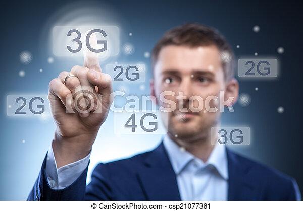 man pressing 3g touchscreen button - csp21077381