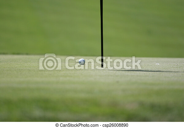Man putting on the golf green - csp26008890
