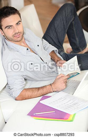 Man reading at home - csp8807293