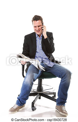 man reads newspaper phoning - economy news - csp18430728