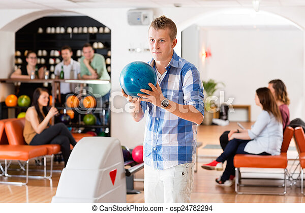 Man Ready With Bowling Ball in Club - csp24782294