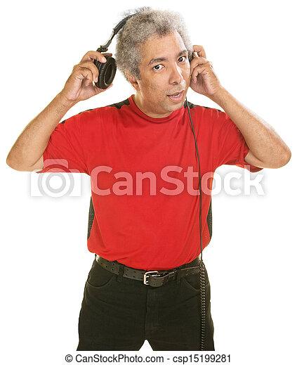 Man Removing Headphones - csp15199281