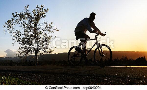Man riding his bike - csp0040294