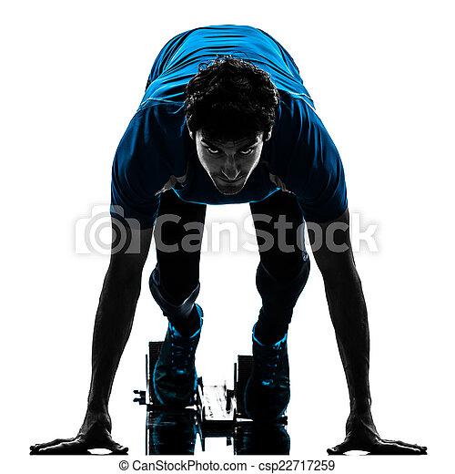 man runner sprinter on starting blocks   silhouette - csp22717259