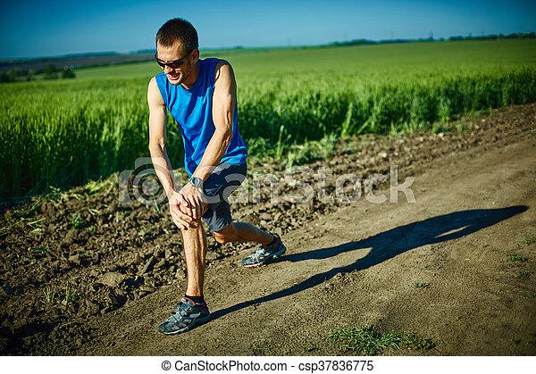 man runner warming up before jogging - csp37836775