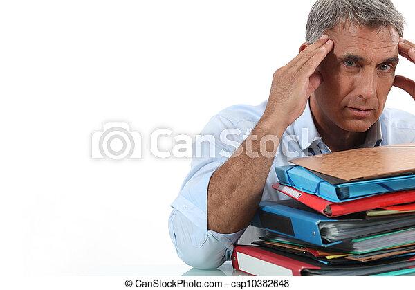 Man sat in front of paperwork - csp10382648