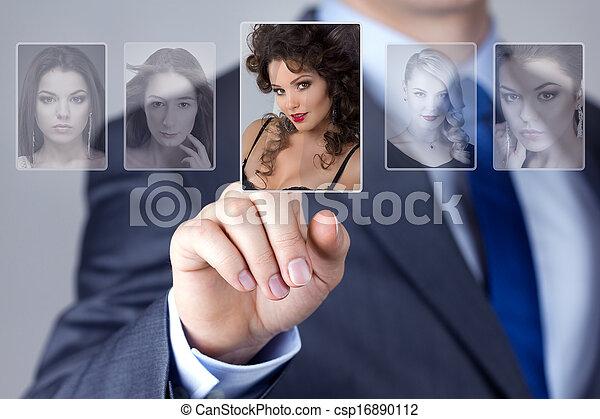 Man selecting a woman portrait image - csp16890112