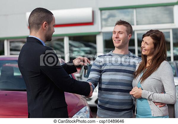 Man shaking hand with salesman - csp10489646