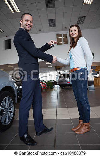 Man shaking hand with woman - csp10488079