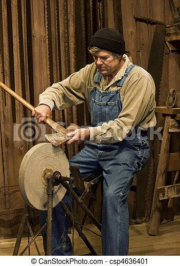 Prime Man Sharpening An Axe On A Grinding Stone Machost Co Dining Chair Design Ideas Machostcouk