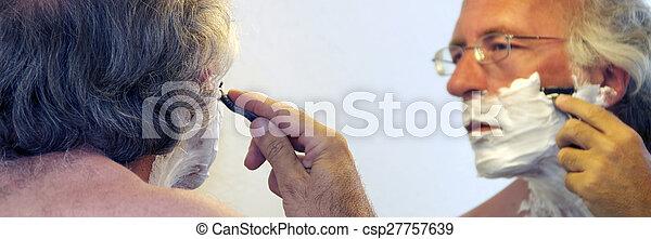 man shaving in mirror - csp27757639