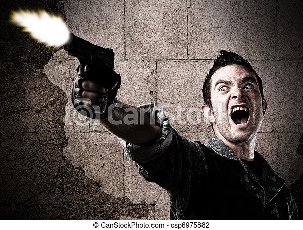 man shooting a gun - csp6975882