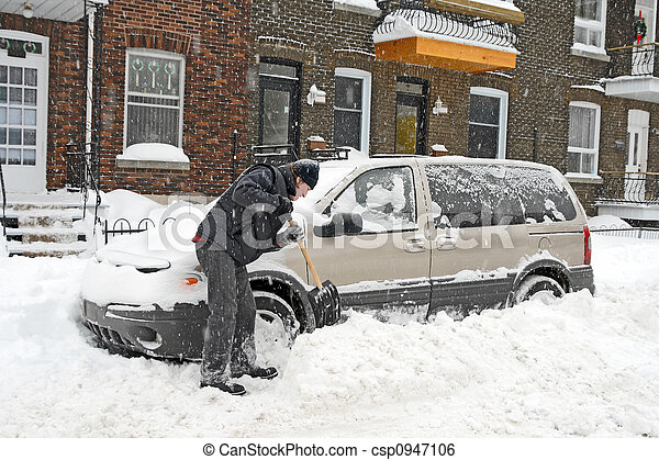 Man shovelling and removing snow - csp0947106