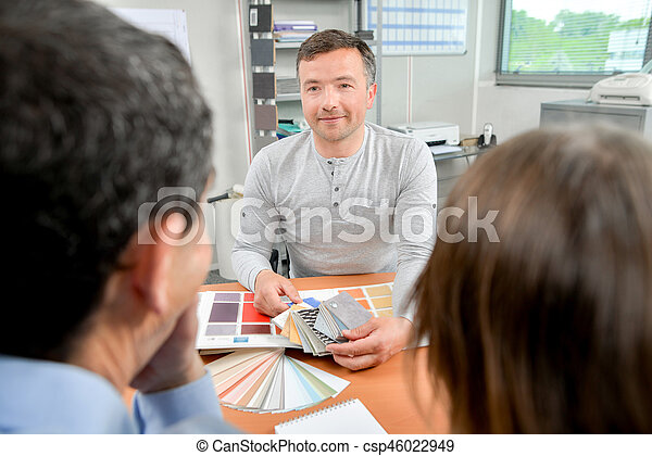 Man showing color swatches to couple - csp46022949