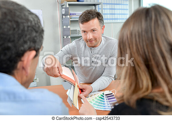 Man showing paint samples to a couple - csp42543733