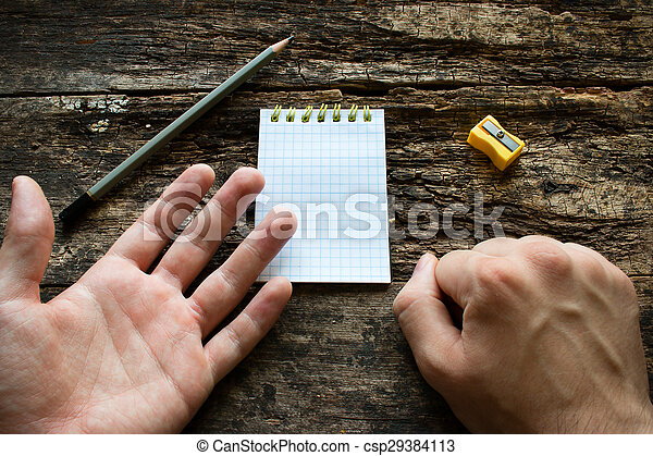 man shows that he is left-handed International Lefthanders Day - csp29384113