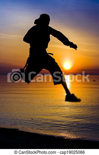 Man Silhouette at Sunrise at the Lake - csp19025066