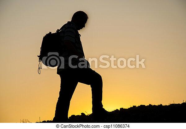 man silhouette on sunset - csp11086374