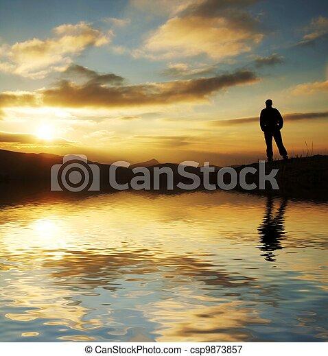 Man silhouette on sunset - csp9873857