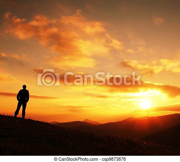 Man silhouette on sunset - csp9873878