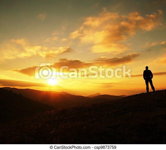 Man silhouette on sunset - csp9873759