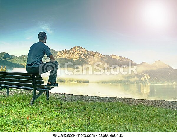 Surprising Man Sit On Wooden Bench At Coast Of Lake Bellow Blue Mountains Ocoug Best Dining Table And Chair Ideas Images Ocougorg