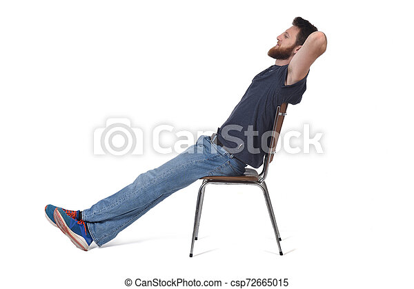 man sitting and relaxed on a chair on white - csp72665015