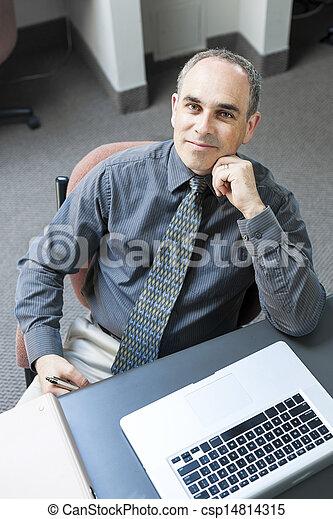 Man sitting at office desk - csp14814315