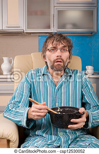 man sitting in chair with pot - csp12530052