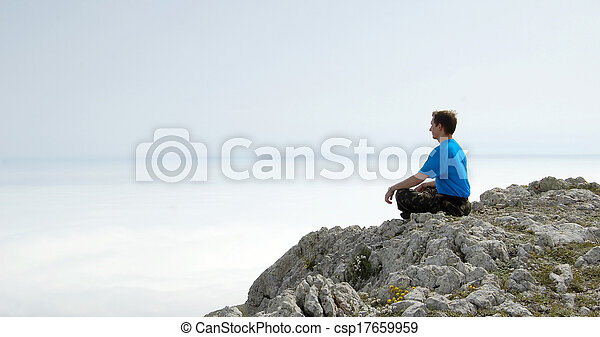 Man Sitting in the Lotus Position on the Rock Above the Sea - csp17659959