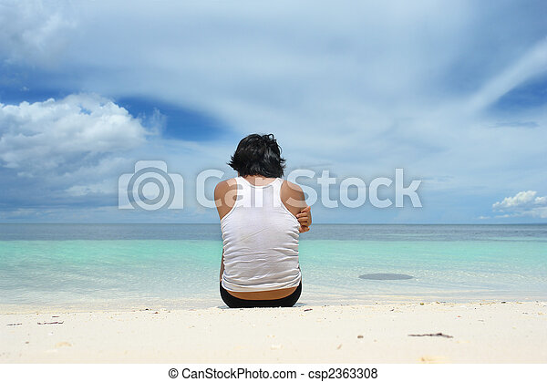 Man sitting lonely on beach - csp2363308