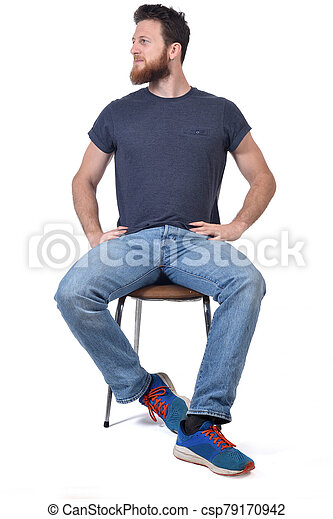 man sitting on a chair look side on white - csp79170942