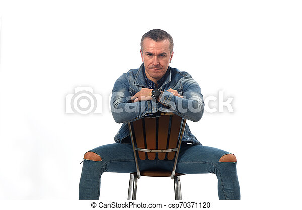 man sitting on a chair with white background - csp70371120