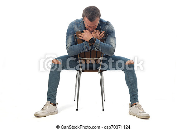 man sitting on a chair with white background - csp70371124