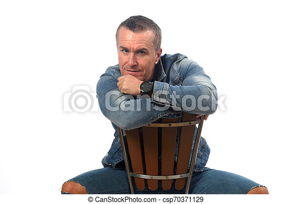 man sitting on a chair with white background - csp70371129